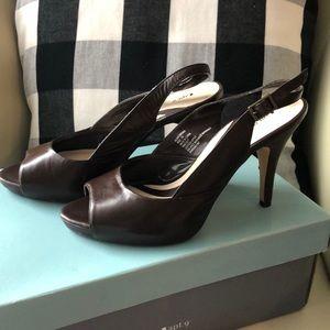 Brown sling back heels, open toe and 3 inch heel.